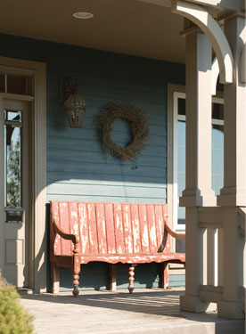 distressed bench adds charm to this covered porch