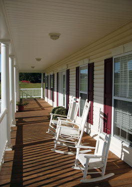 covered porch furniture. symmetrical country homeu0027s covered porch furniture