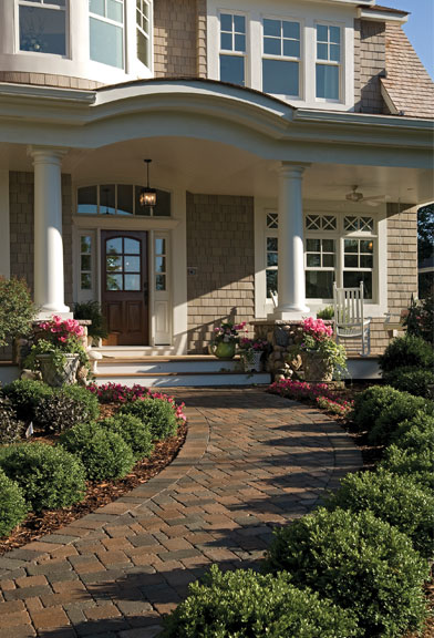 inviting front entry with flowers and attractive walkway