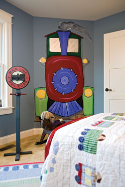 child's bedroom with train wall mural.