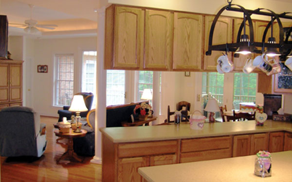 warm hued galley style kitchen