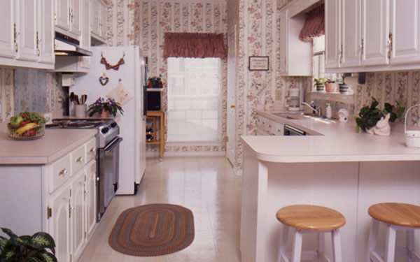 galley style kitchen with plenty of storage space