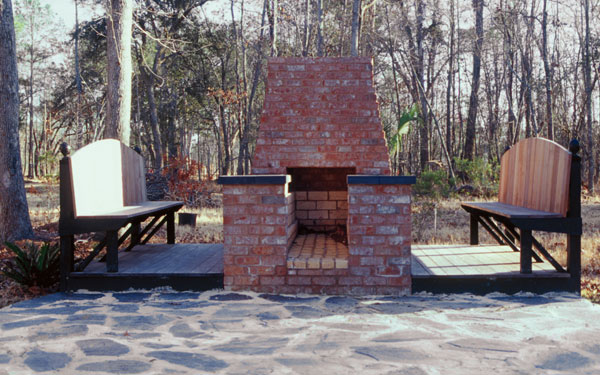 great bricked firepit area with stone patio floor