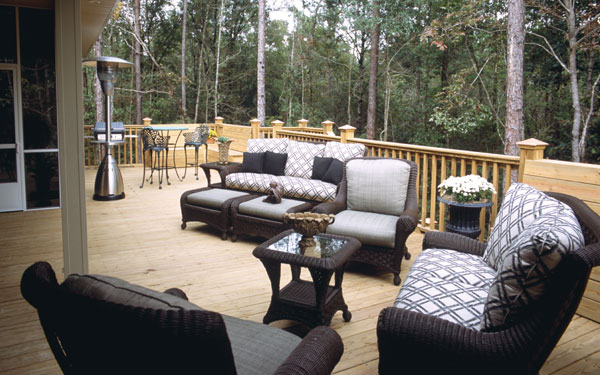 sprawling deck with comfortable outdoor furniture