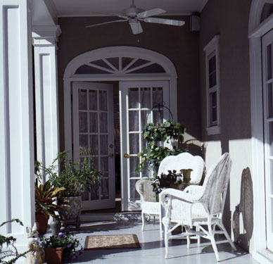 covered porch with white wicker furniture