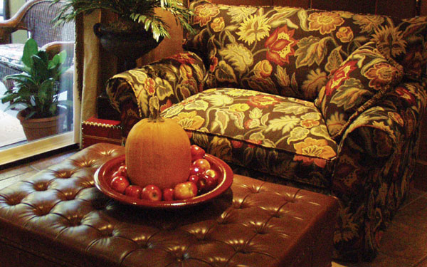 family room in dream home plan with pumpkin decoration