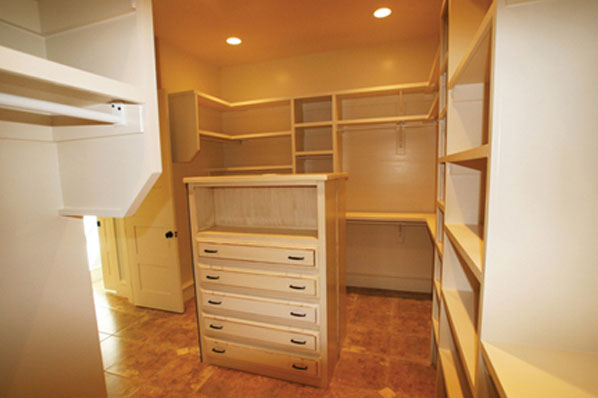 empty oversized luxury style master bedroom closet