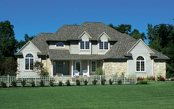 Traditional two-story home design with attractive front yard fence