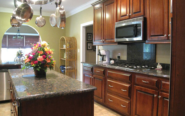 Traditional style kitchen with fresh colorful flower arrangement