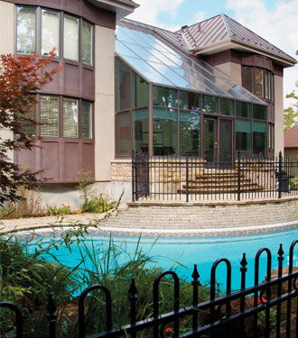 house with swimming pool and surrounding fence
