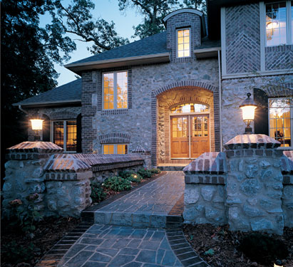 Grand European house plan with striking stone walkway entrance