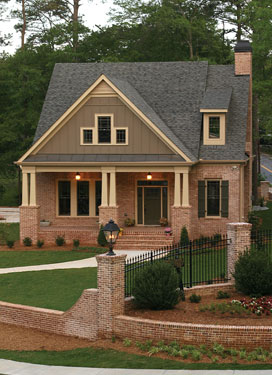 A modified craftsman style home with a brick veneer and Brick craftsman house