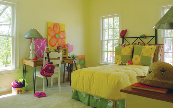 cheerful girl's bedroom with desk