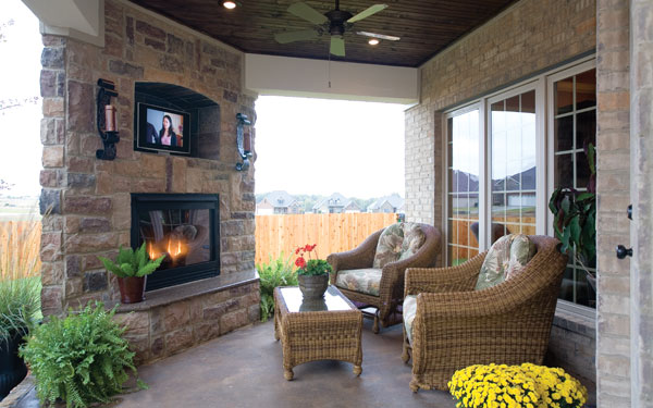 outdoor covered patio with flat screen television