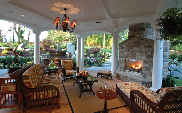 stunning covered outdoor living area with fireplace