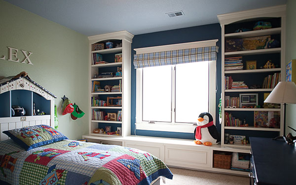 stylish children's bedroom with bookshelves