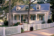 charming country home with white picket fence