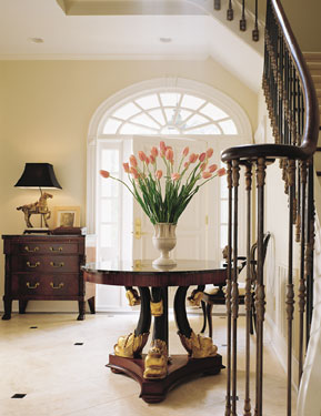 entry foyer with dramtic flower arrangement
