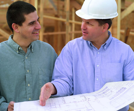 homeowner and builder discussing changes to a house plan