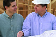 homeowner with contractor reviewing blueprints