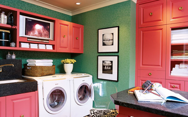 Stylish laundry space with plenty of storage for linens, towels and supplies