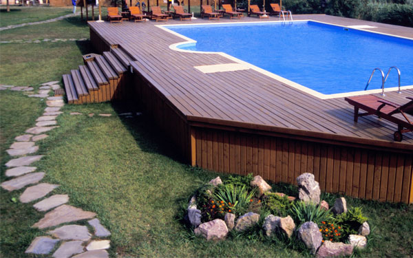 above ground pool with a stepping stone path