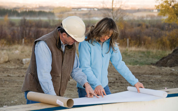 woman and contractor discussing changes to a house plan design