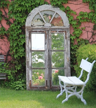 country style garden with decorative mirror enlarges space