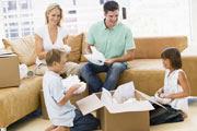 family unpacking boxes in their dream home