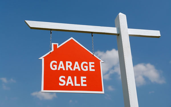 bright red garage sale sign