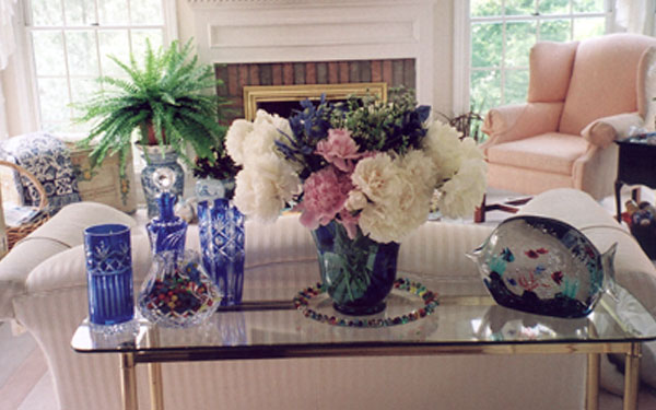 Light and airy hearth with large bouquet of peonies in a vase