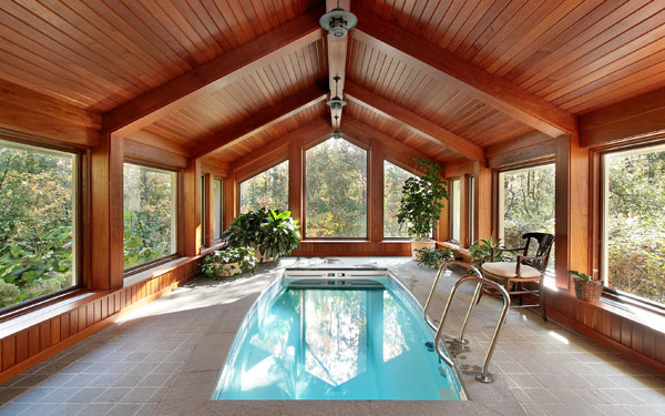 Design tips for indoor swimming pools house plans and more for Pool and garden house plans