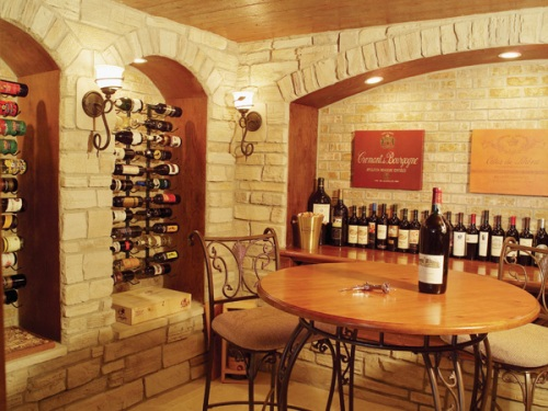 luxury wine cellar with stone walls and seating