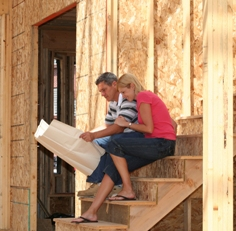 Couple in construction site for a new home