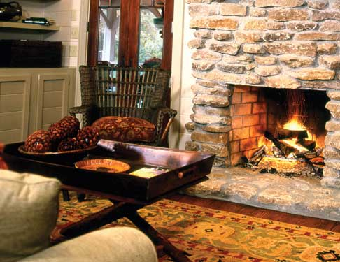 warm fireplace with fall decor