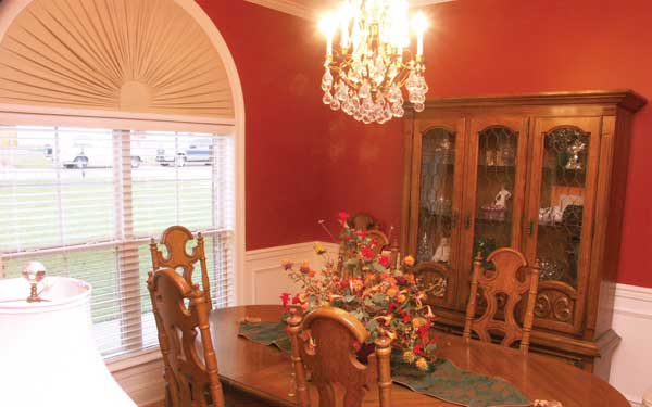 dining room with country style hutch