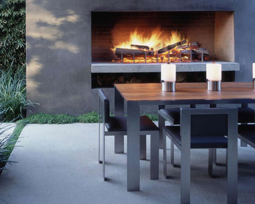 contemporary style outdoor fireplace and dining area