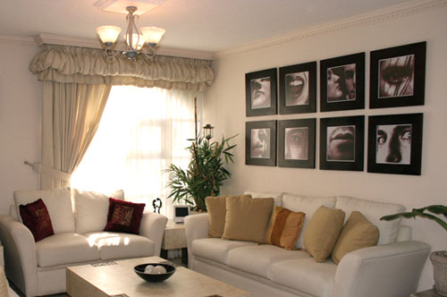 framed picture arrangement above couch in living room
