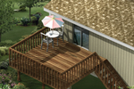 Raised wood patio deck has stairs to the ground level below and plenty of space for entertaining