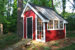 This stylish garden shed has a rustic exterior with sleek atrium windows and a French door entry