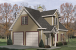 Charming two-car garage with interior space, large dormer and covered porch