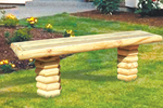 Landscape timber bench is te perfect style for a log home plan