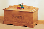 Old-fashioned wood toy chest includes a place for personalizing