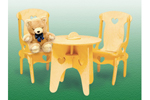This doll's table and chairs includes a table with heart cut-outs and two chairs of the same design