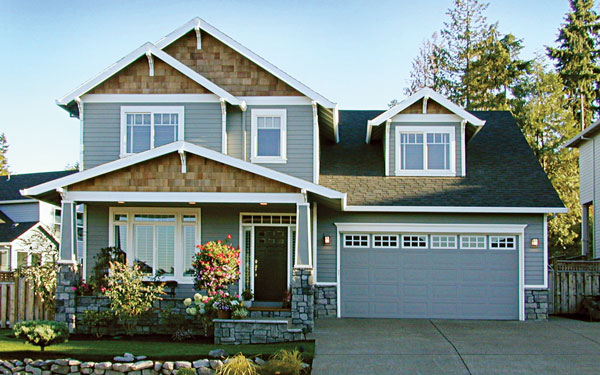 Craftsman Home Exterior craftsman house. mission style home. wood garage door. brown