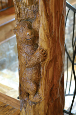 staircase detail with carved wood bear