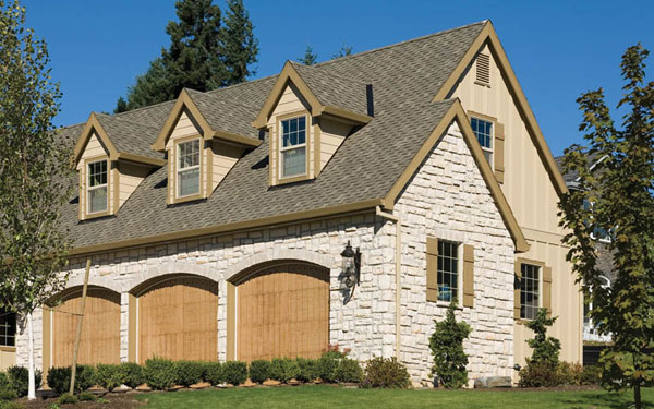 attached three car side entry garage view this house plan