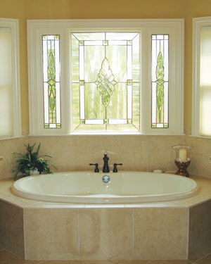 beautiful stained glass window above whirlpool tub