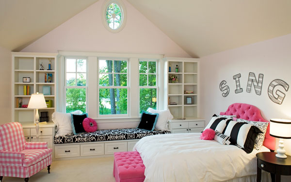bookcases flanking a window in a bedroom