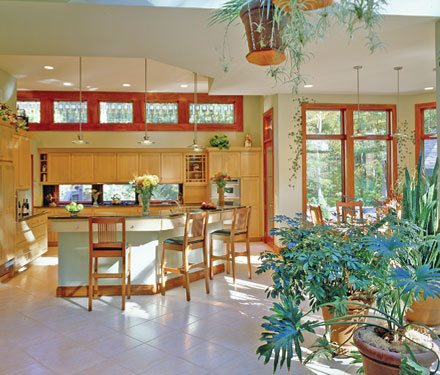 open kitchen floor plan with many plants and skylights